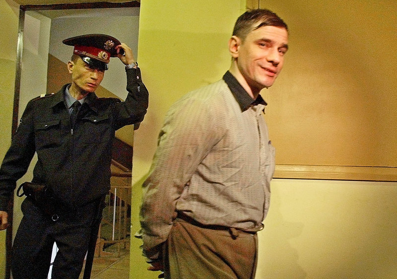 Igor Sutyagin, a Russian jailed for allegedly spying for the U.S., is escorted in 2002 to a Moscow courtroom. Sutyagin reportedly arrived in Vienna Thursday as part of the spy swap.