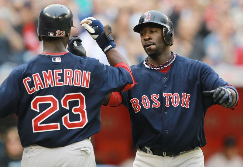 Mike Cameron, left, and Bill Hall celebrate Hall's two-run homer Friday during Boston's 14-3 victory against Toronto.