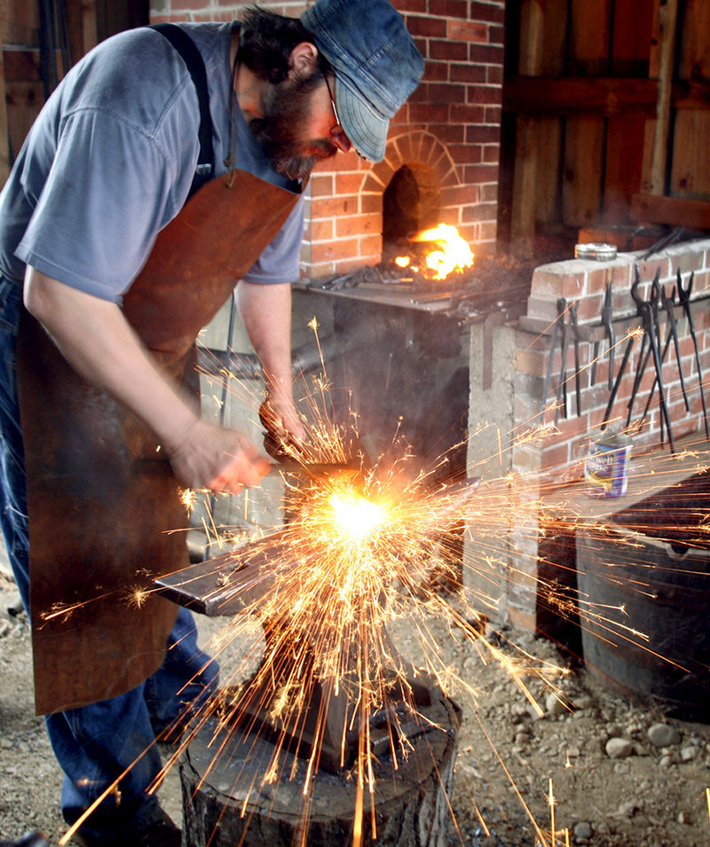Blacksmith Tim Greene of Parsonsfield hammers out a link for a horse chain during a demo at the fair.