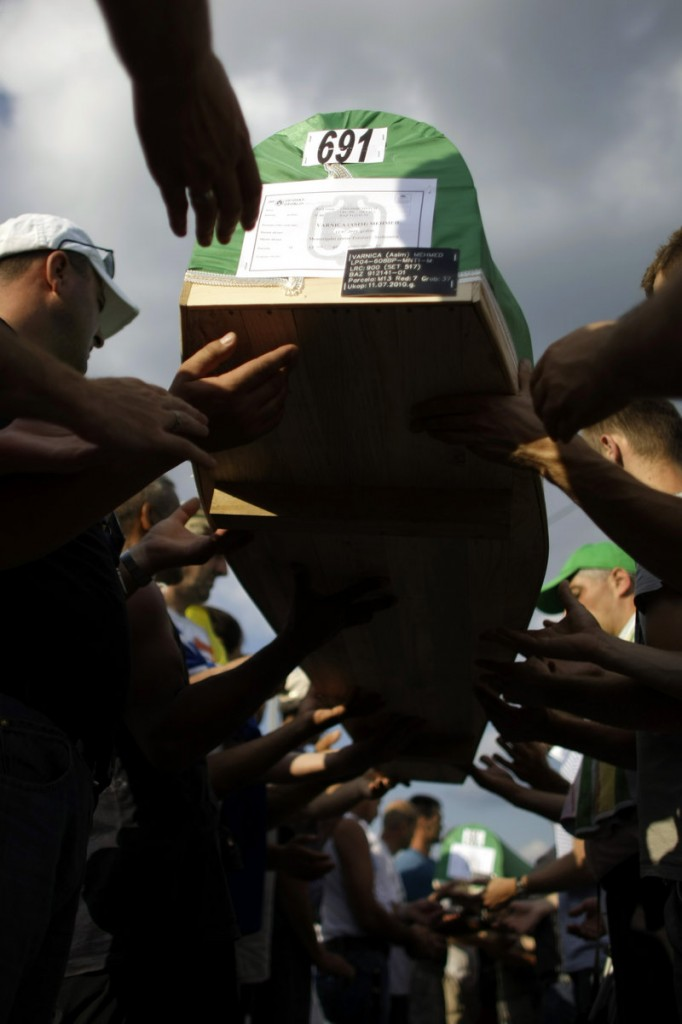 Men carry coffins of victims of the 1995 Srebrenica massacre in Potocari, Bosnia-Herzegovina, on Saturday. Some 775 bodies excavated from mass graves will be buried today.