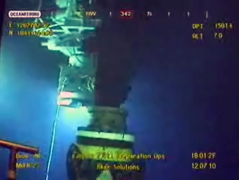 The Associated Press This is a two-line cut In LEFT PICis image taken from video provided by BP PLC at 18:01 CDT, oil flows from the broken well, center, as a new containment cap, left, hovers near the site of the Deepwater Horizon oil spill in the Gulf of Mexico, Monday, July 12, 2010. Deep-sea robots swarmed around BP's ruptured oil well Monday in a delicately choreographed effort to attach a tighter-fitting cap that could finally stop crude from gushing into the Gulf of Mexico nearly three months into the crisis RIGHT PICthis image taken from video provided by BP PLC at 18:17 CDT, a new containment cap, top, is lowered over the broken wellhead at the site of the Deepwater Horizon oil spill in the Gulf of Mexico, Monday, July 12, 2010. Deep-sea robots swarmed around BP's ruptured oil well Monday in a delicately choreographed effort to attach the tighter-fitting cap that could finally stop crude from gushing into the Gulf of Mexico nearly three months into the crisis. (AP Photo/BP PLC) NO SALES