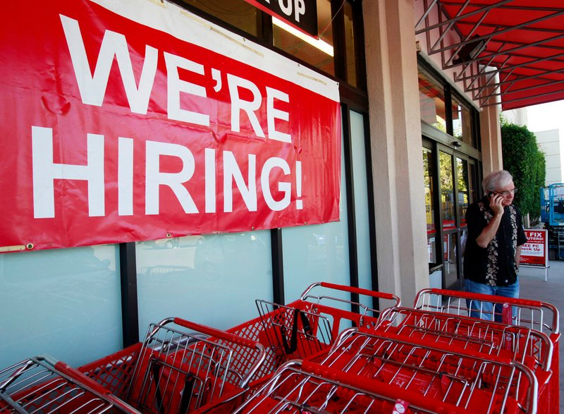 """A """"We're Hiring"""" banner hangs near the entrance of an Office Depot in Mountain View, Calif., on Monday. Hiring overall, however, is sluggish – May's job openings were 37 percent above the low point set in July, 2009, but are far below pre-recession levels."""