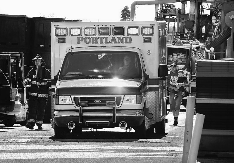 A Medcu ambulance transports injured people to one of Portland's two hospital emergency rooms.