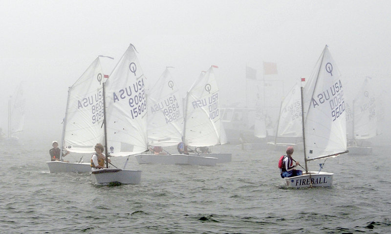 The young sailors in the Optimist class wait for the fog to clear Tuesday while preparing to race in Casco Bay during the opening day of the USA Junior Olympic Sailing Festival Northeast Youth Championships. The fog eventually did burn off.