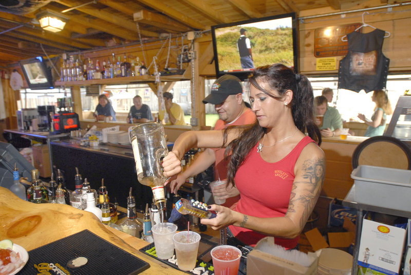 Bartender Melanie Pearson mixes drinks at Bentley's Saloon in Arundel. It's popular with bikers, but its blend of food, drink and entertainment draws all kinds.