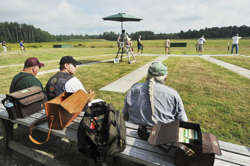 As the competitors fire away in the state's longest-running shoot – 120 years and counting – spectators and other contestants keep watch on the proceedings.