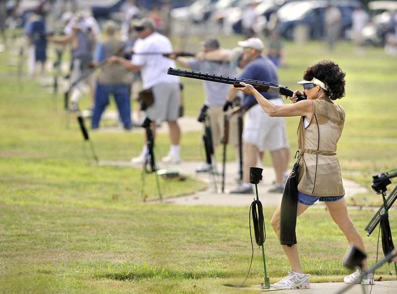 Barbara Wyman, foreground, of Gorham takes her shots Thursday during the opening day of the four-day Maine State Trapshoot at the Scarborough Fish & Game Club at 70 Holmes Road.