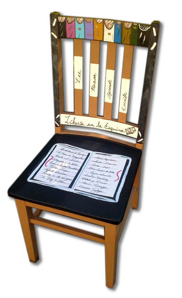 """This chair is titled """"Libreria en la Esquina,"""" translated to """"Corner Bookstore."""" The chair honors Chicana writers in the """"book"""" on the seat."""