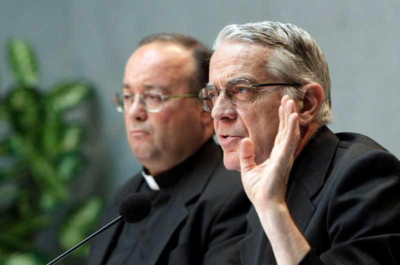 Vatican spokesman the Rev. Federico Lombardi, right, and Monsignor Charles Scicluna talk to the media Thursday.