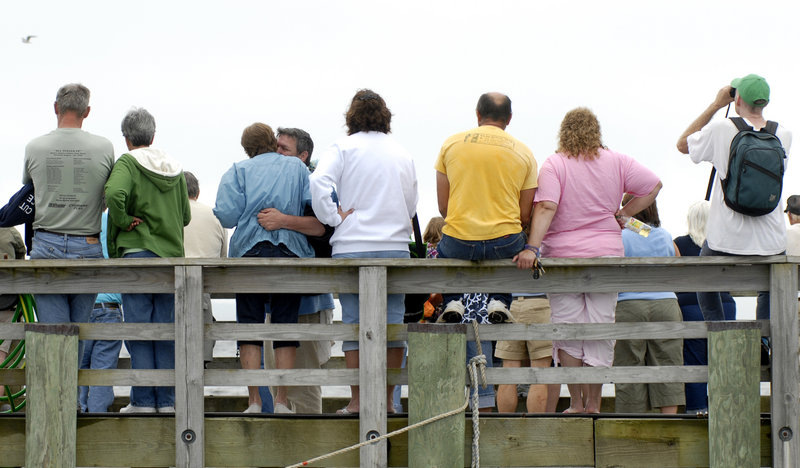 Spectators line the Searsport town dock to watch the race. Competitors, helped by family and friends, raced on a three-quarter mile drag strip.