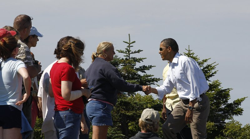 Obama greets visitors on Cadillac Mountain in Acadia National Park.