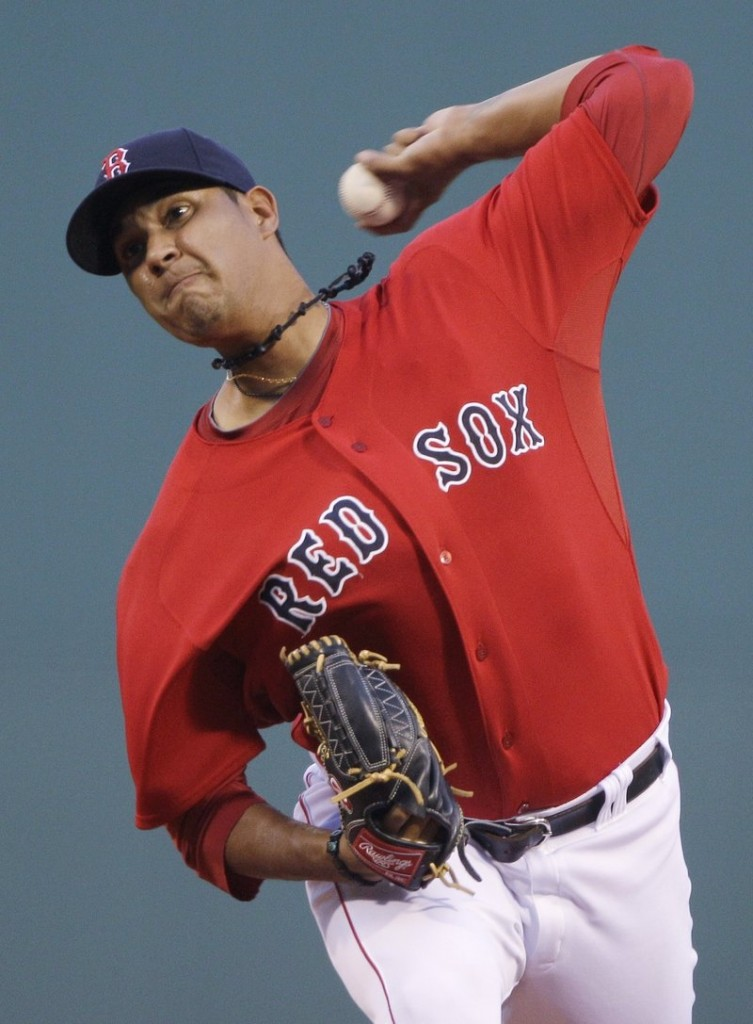 Felix Doubrount delivers a pitch against the Texas Rangers on Friday night at Fenway Park. The Rangers got to Doubrount early, scoring two runs in the first.