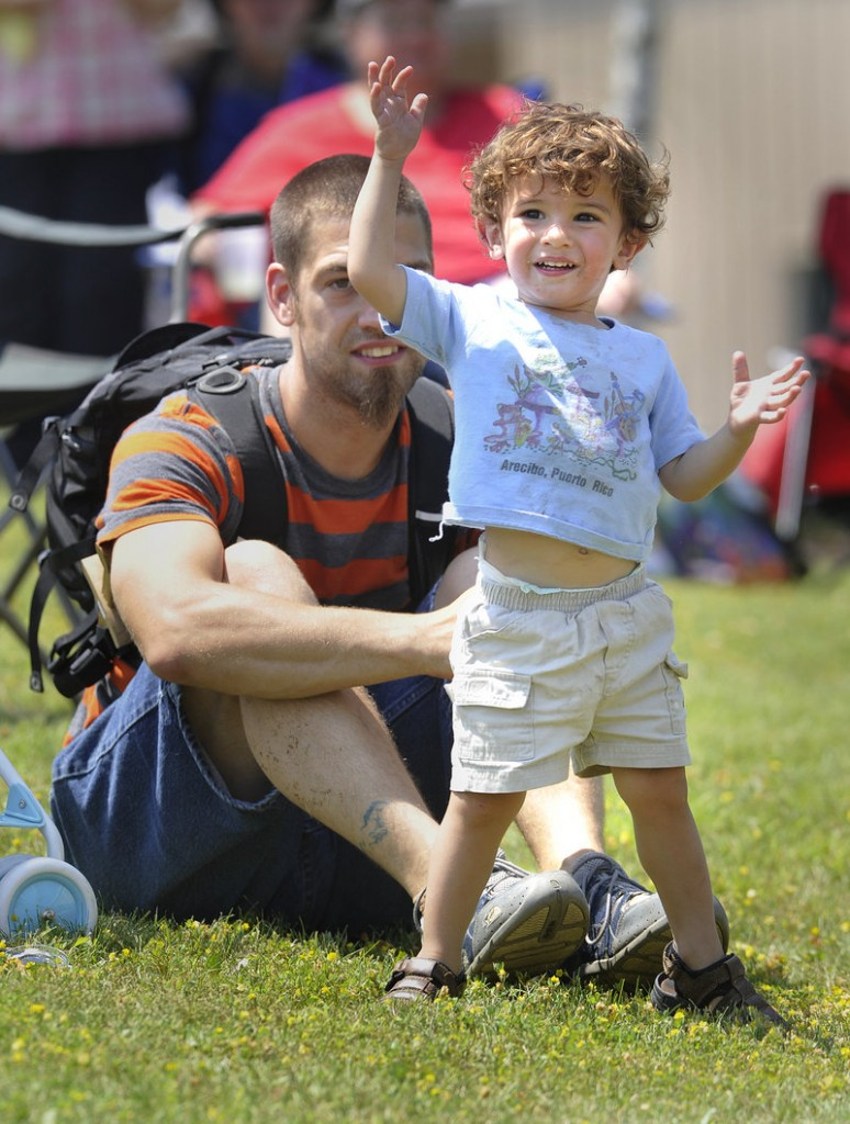 Darby Ricker, 2, dances to an Irish jig being played on the festival's music stage Saturday. Darby and his dad, Corey Ricker, are from Hampden.