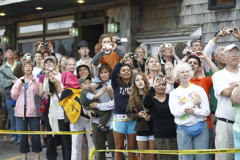 Crowds of camera-clicking onlookers gather to catch a glimpse and a photo of President Obama and his family as they leave a restaurant after dinner in Bar Harbor on Friday evening.