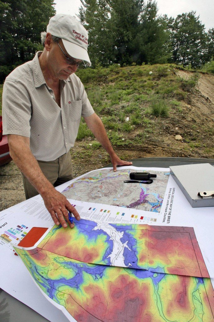 Geologist John Brooks checks maps in New Hampton, N.H. Brooks is helping to map the state's subsurface.