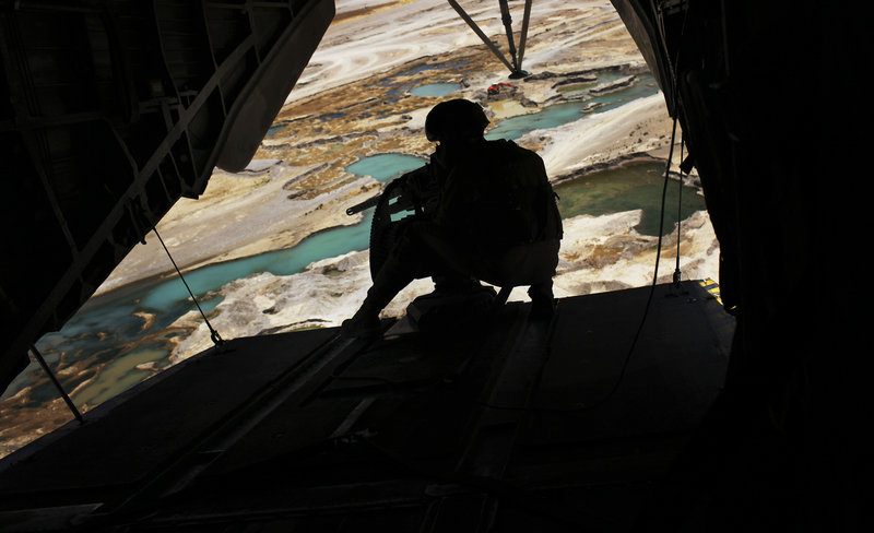 A Marine helicopter door gunner holds a heavy machine gun during a flight over Nimroz province on the border with Helmand province in southern Afghanistan on Saturday.