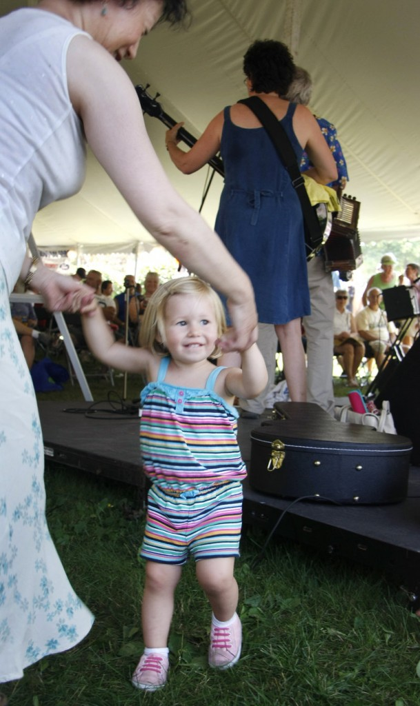 Two-year-old Grace Mike of Arizona dances with a friend to the tunes of JimmyJo & the Jumbol'ayuhs.