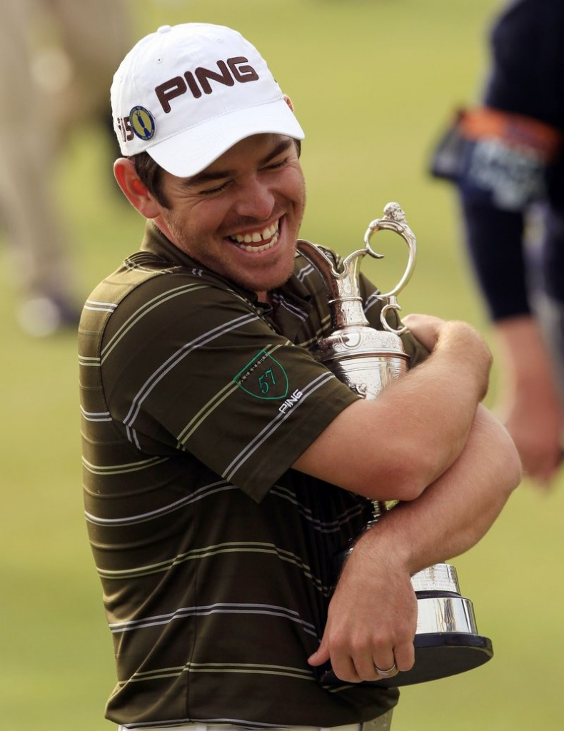 Louis Oosthuizen of South Africa wraps his arms around the silver claret jug that is the oldest of golf's major trophies after winning the British Open on Sunday.