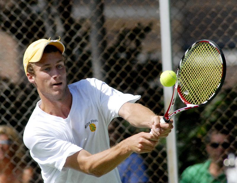 Mike Hill of Topsham returns a shot during Sunday's men's singles final. Hill, the No. 1 seed and defending champion, lost 6-2, 6-4 to Ben Cox.