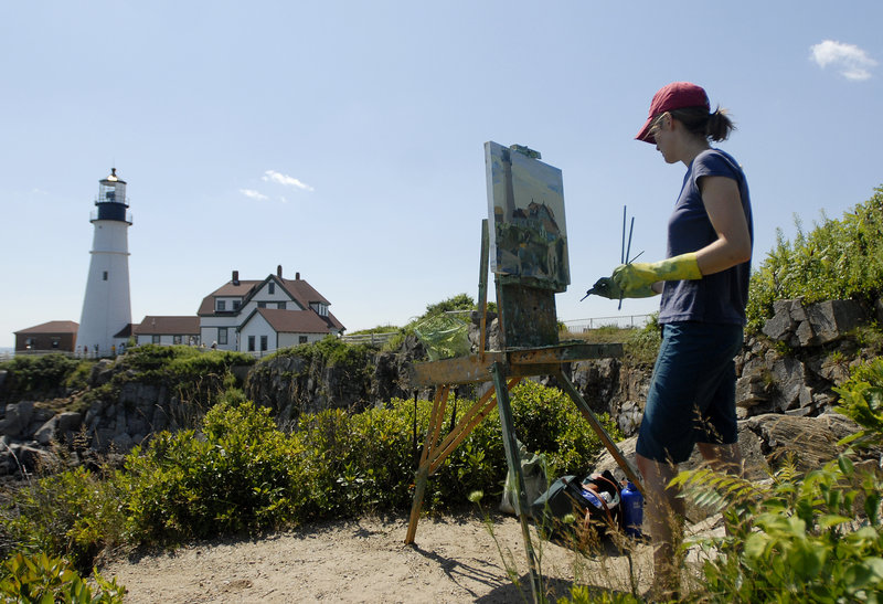 Emily Leonard Trenholm of Bangor paints Portland Head Light in Fort Williams Park for the Paint for Preservation 2010 3rd Annual Wet Paint Auction Sunday.