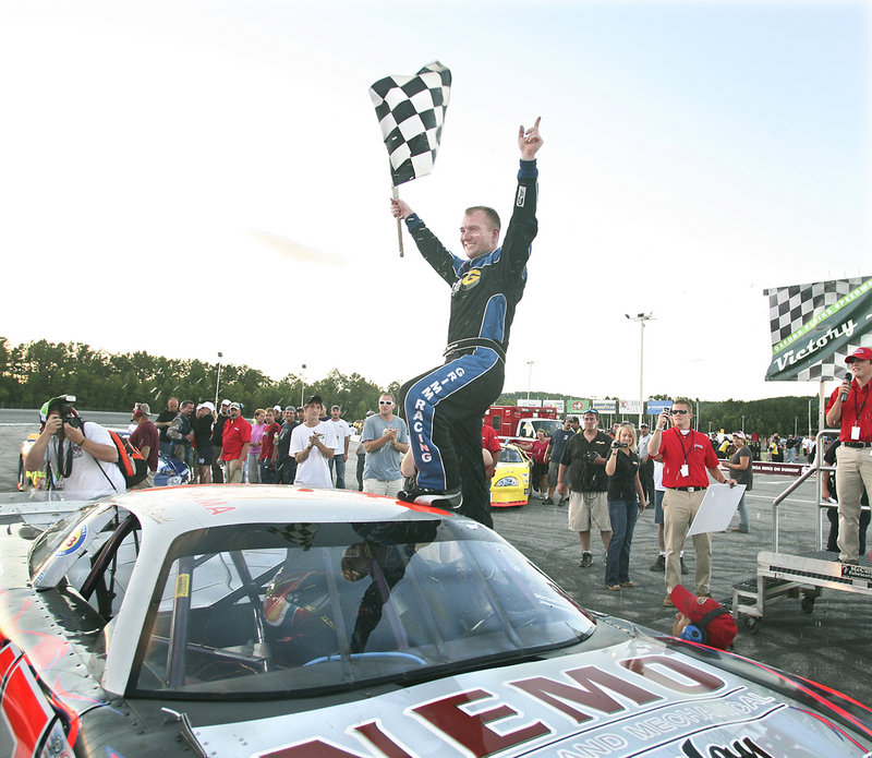 Eddie MacDonald celebrates his second consecutive victory in the TD Bank 250 on Sunday at Oxford Plains Speedway. It was MacDonald's fourth straight win at the track.