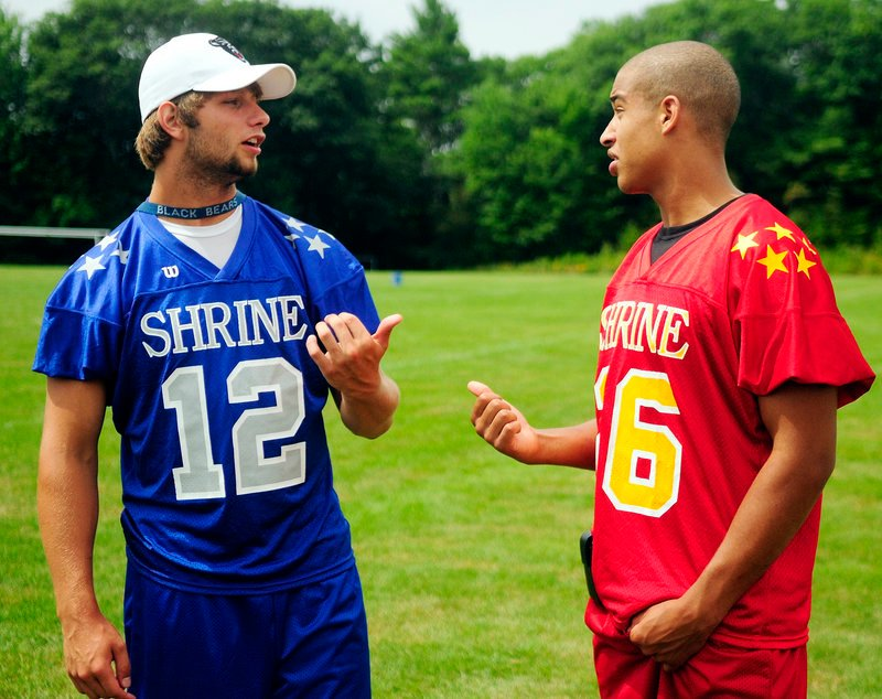 Windham's Jackson Taylor, left, talks with Brunswick's Rashon Edgerton on Tuesday during Lobster Bowl Media Day at Hebron Academy. Both will play at UMaine this fall.