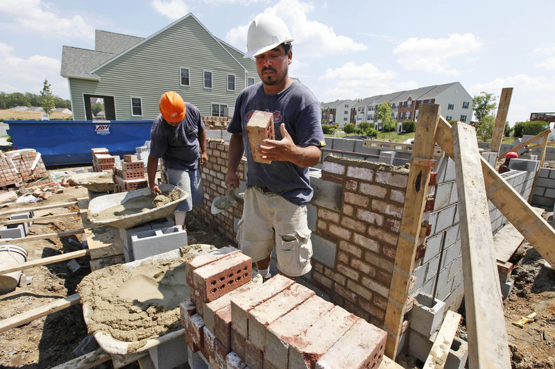 A mason lays brick on a foundation for a new home last week in Richmond, Va. Home construction plunged last month to the lowest level since October as the economy remained weak and demand for housing plummeted.