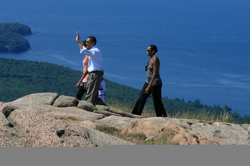 President Obama waves as he and first lady Michelle Obama and their daughters take in Cadillac Mountain in Acadia National Park last weekend.