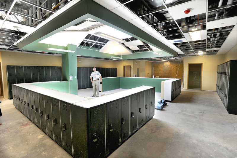 Architect Michael Johanning looks up at a skylight in one of the small-group areas at the new Ocean Avenue Elementary School. The project is $5.4 million under budget.