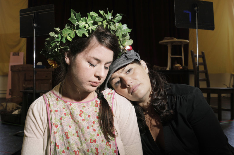 "Angela Mortellaro as Gretel and Heather Johnson as Hansel rehearse a scene in which they drift off to sleep in PORTopera's ""Hansel and Gretel."" The opera will be performed at Merrill Auditorium on Thursday and Saturday."
