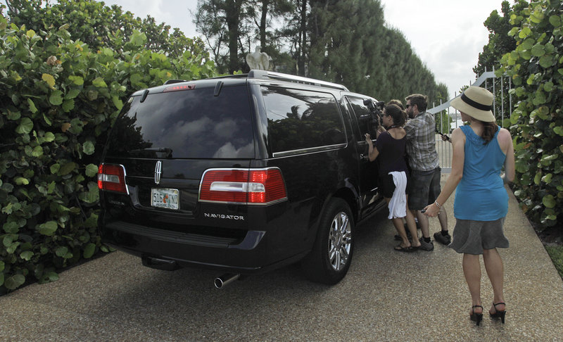 The media flock around the SUV carrying Conrad Black to his Palm Beach, Fla., home Wednesday.