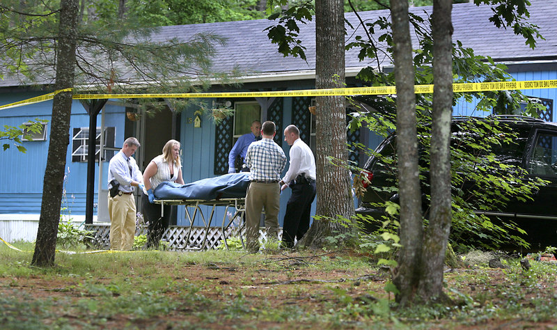 A body is removed from a mobile home Wednesday on Brook Drive in Hollis. Police believe that Mike Lagarde shot his wife, Freda, then shot himself in a murder-suicide. Their adult daughter found the bodies.