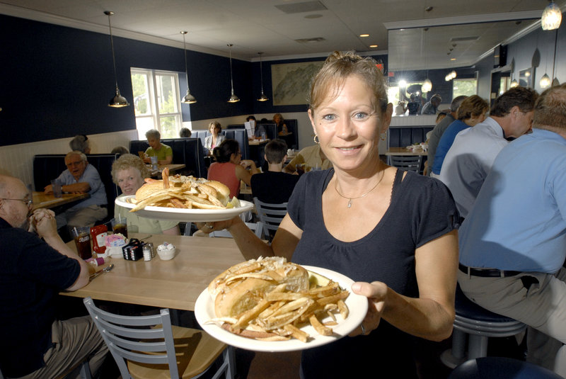 Server Judy Dyer hoists a couple of Burn Dog plates (hot dog with sauerkraut and side of fries).