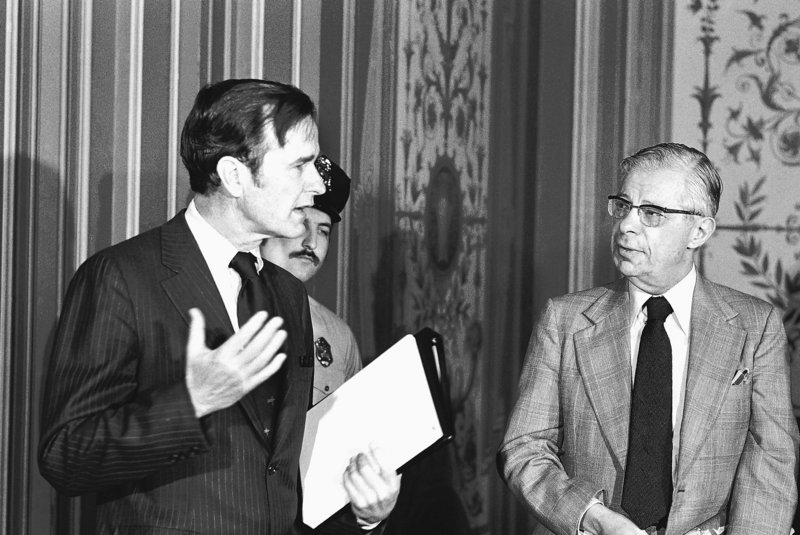 CIA Director George Bush, left, exchanges words with CBS newsman Daniel Schorr in 1976 before Bush's closed-door briefing to members of the Senate Foreign Relations Committee.