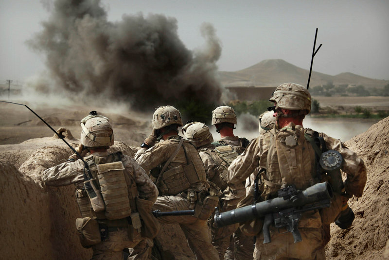 Marines from Bravo Company of the 1st Battalion, 2nd Marines, watch an explosion after calling in an airstrike as part of an operation to clear the area of insurgents near Musa Qaleh, in northern Helmand Province, southern Afghanistan, on Friday.