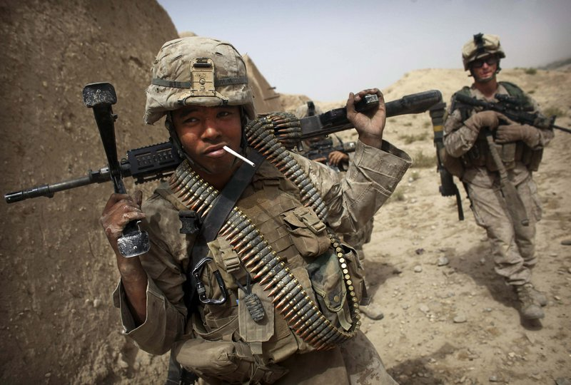 Lance Cpl. Brian Quinnones from Bravo Company of the 1st Battalion, 2nd Marines, has an unlit cigarette in his mouth after the gunbattle near Musa Qaleh on Friday.