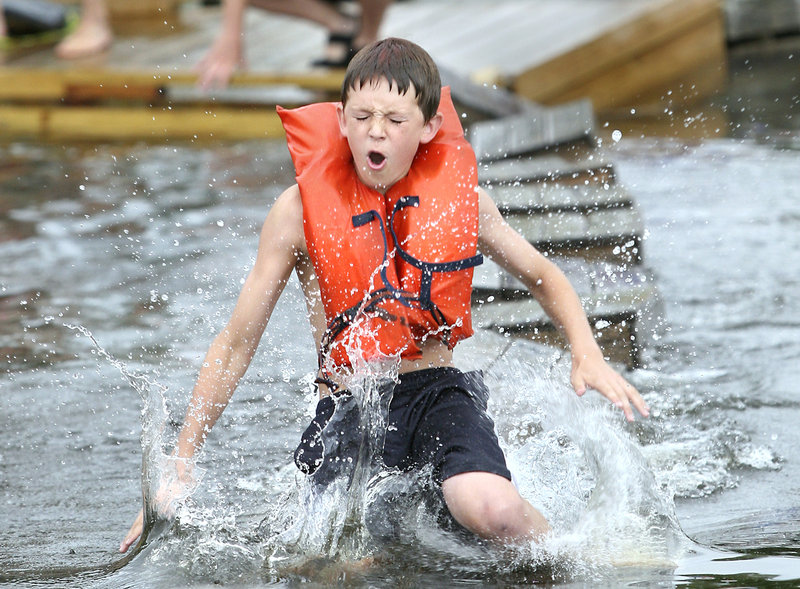 Nate Vintinner, 13, of Richmond jumps into the water during the lobster crate races.