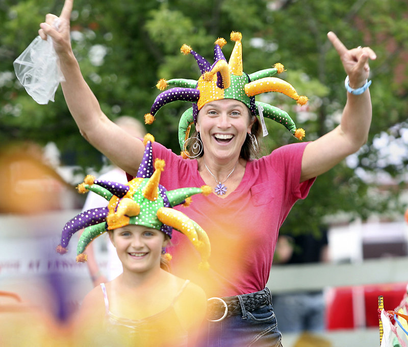 Andrea Kalkstein of Carlisle, Mass., celebrates with her daughter Suzanne after winning jester hats while competing in a three-legged race during Richmond Days on Saturday.