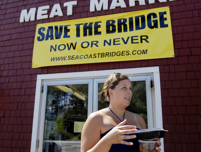 Sarah Caine of Kittery talks about Memorial Bridge after shopping at Carl's Meat Market in Kittery, where a Save the Bridge sign is on display.
