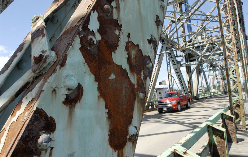 A truck crosses the rusty Memorial Bridge that links Portsmouth, N.H., and Kittery. While a citizens group is pressing for keeping open both the Memorial and the Sarah Mildred Long bridges, Maine Gov. John Baldacci is reserving judgment until a study is complete.