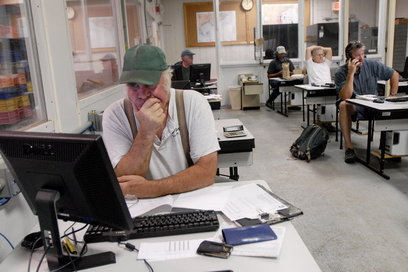 Mickey Varian of Sebasco Wharf Inc. watches the auction online at the Portland Fish Exchange on Thursday.