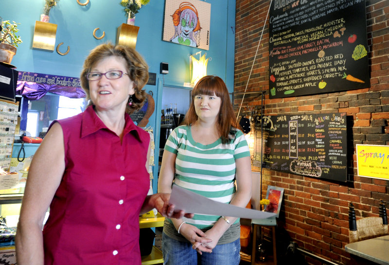 "Linda Converse, left, and her daughter Ellen own and operate Oh Baby Cafe on Main Street in Biddeford. Restaurateurs in the region are finding breakfast to be ""recession-proof."""