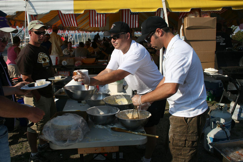 Volunteers fry the day's catch at last year's Veterans Appreciation Fishing Tournament in South Portland.