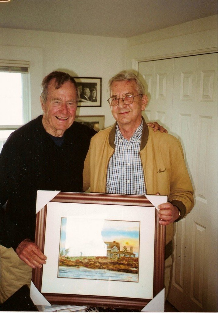 Former President George H.W. Bush poses with Dick Anzelc and one of his paintings of Walker's Point in Kennebunkport.