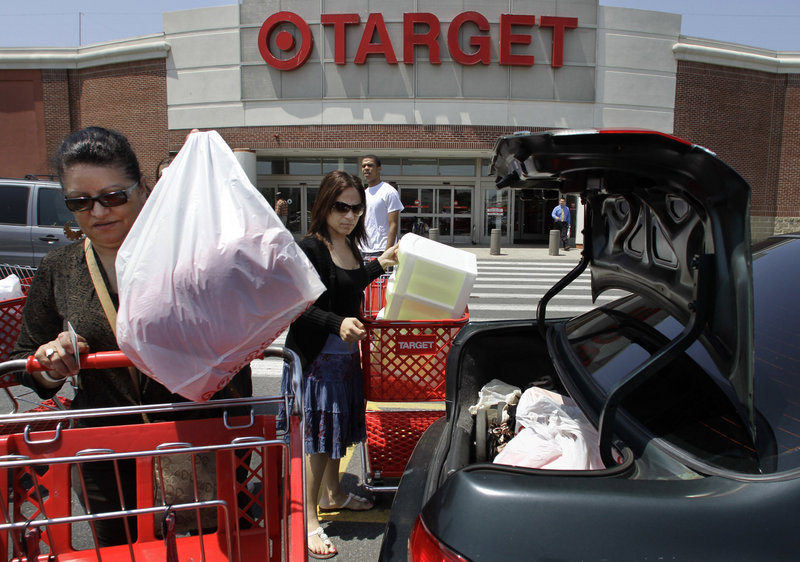 Joselin Pena, left, and her niece Ingrid Romero put their purchases in their car at a Target in Boston. A political donation by Target to a candidate who opposes gay marriage has led to talk of boycotts and a Facebook drive against corporate donations.