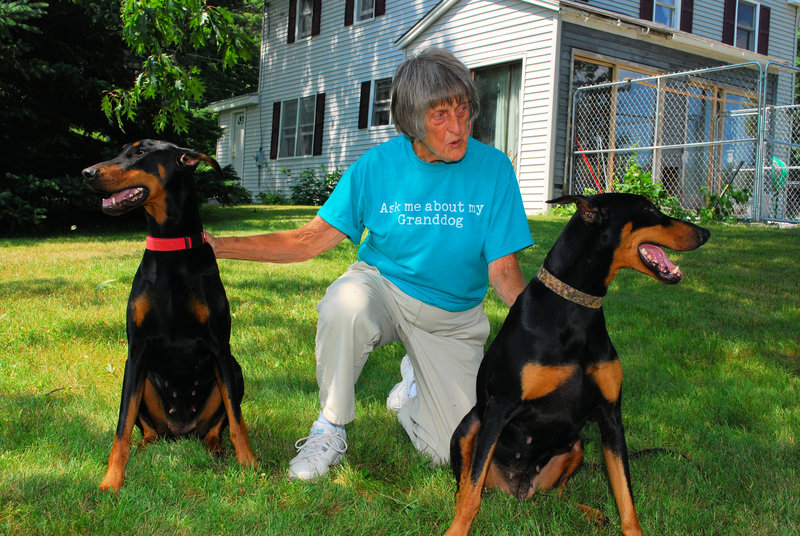 Evelyn Stackpole with her dogs Glory and Paige, two of the many Doberman pinschers she raised and trained.