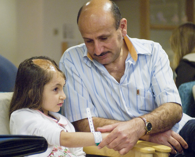 Six-year-old Noora Afif Abdulhameed is shown with her father, Afif Adulhameed Otaiwi, as she prepares for a CT scan to assess the extent of her head injury in July 2008 at Maine Medical Center in Portland.