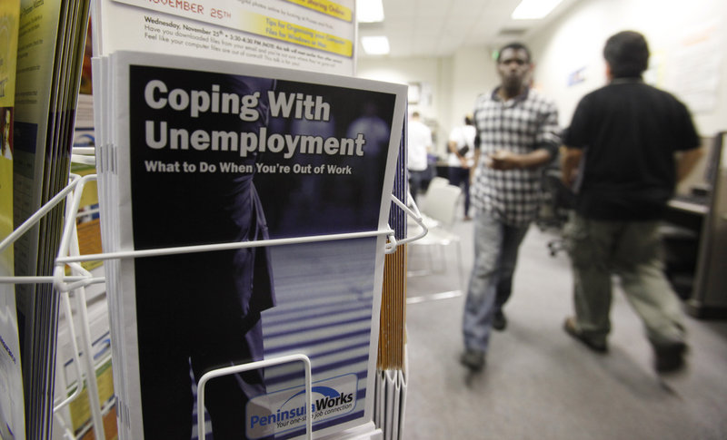 People seek employment opportunities at an employment office in Menlo Park, Calif. The recovery lost momentum in the second quarter as growth slowed to a 2.4 percent pace, its most sluggish showing in nearly a year.