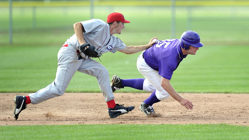 Corbin Hyde, the pitcher for Gayton Post of Lewiston, slaps a tag on Devon Fitzgerald of Nova Seafood during a rundown between second and third base in their American Legion state tournament game Friday at South Portland. Gayton won 8-7 with a three-run ninth inning.