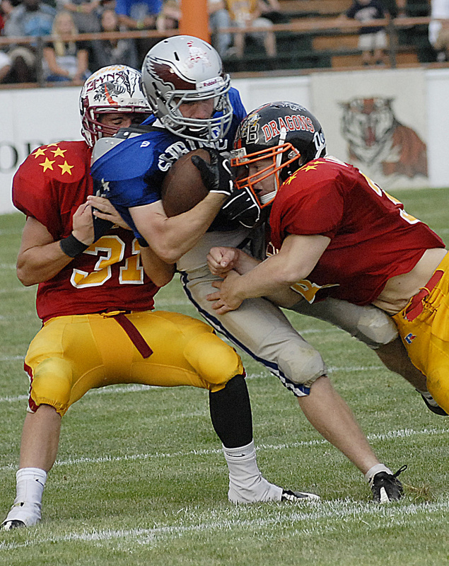 Mike Foley of South Portland runs out of room while hit by Frankie True of Mt. Ararat, right, and Brandon Levasseur of Orono. The annual Lobster Bowl has raised more than $370,000 in 21 years for Shriners hospitals for children.